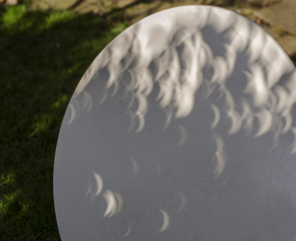 crescent shaped shadows during eclipse