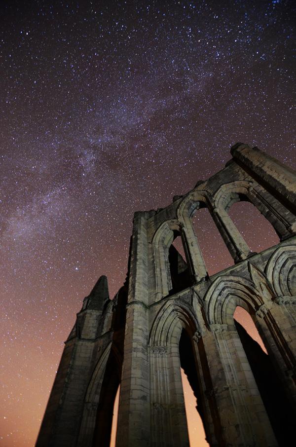 Rievaulx abbey at night milky way at the gates