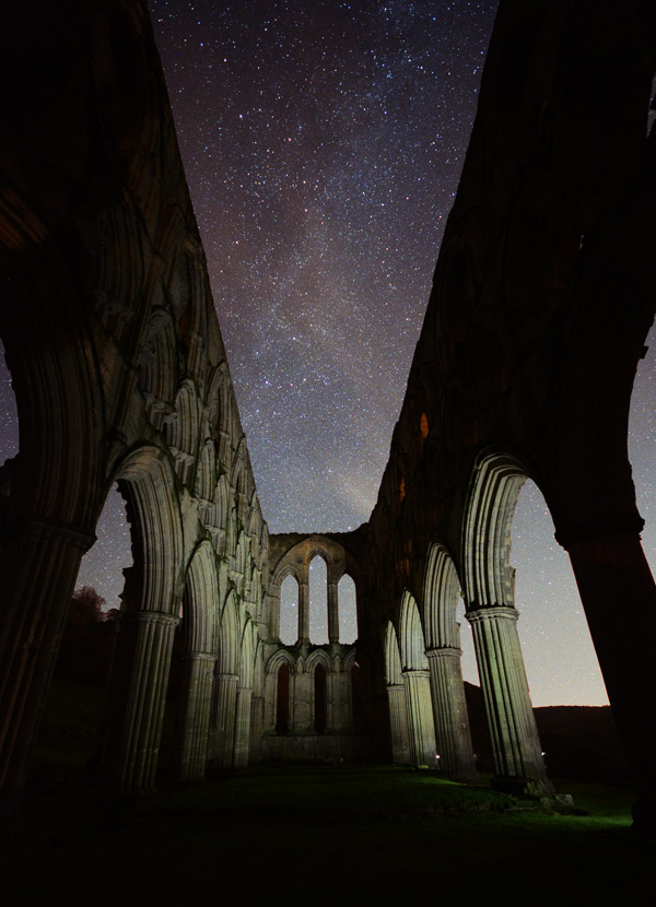 Rievaulx abbey at night milky way under the arches
